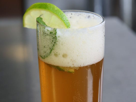 The Beer Mojito is garnished with lime and mint.