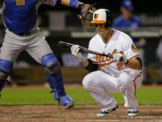 Baltimore Orioles' Steve Pearce reacts after striking out looking in the seventh inning of a baseball game against the Toronto Blue Jays, Tuesday, May 12, 2015, in Baltimore. Toronto won 10-2. (AP Photo/Patrick Semansky)