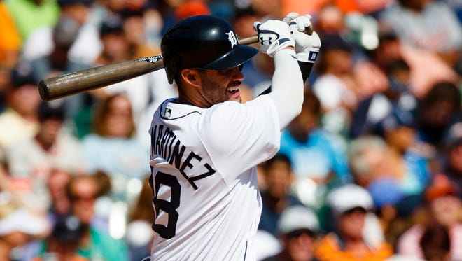 Sep 25, 2016; Detroit, MI, USA; Tigers rightfielder J.D. Martinez hits a double in the third inning against the Royals at Comerica Park.