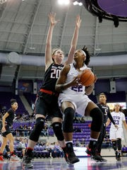 Texas Tech forward Brittany Brewer (20) defends as