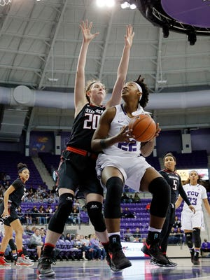 Texas Tech forward Brittany Brewer (20) defends as TCU's Jordan Moore (22) works beneath the basket for a shot opportunity in the second half in Fort Worth Wednesday, Feb. 8, 2017.