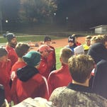 The Annville-Cleona boys soccer team gathers around coach Ray Kreiser, center, after being defeated 3-0 by Boiling Springs in a District 3 Class 2A game Tuesday.
