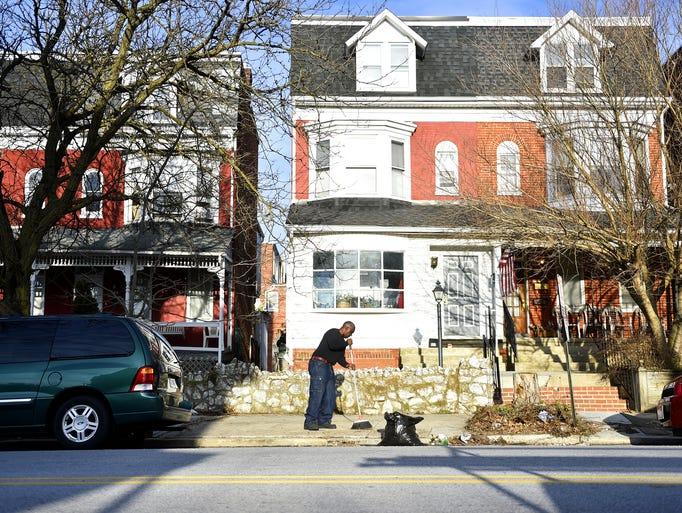 Anthony McClair, 50, originally of Bronx, N.Y., sweeps