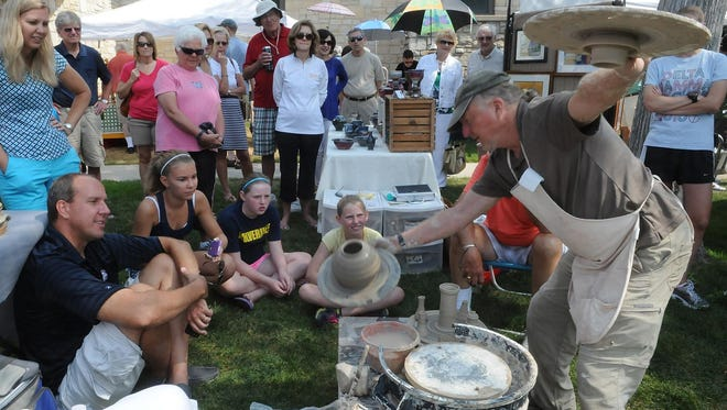 John Hansen of Baileys Harbor reveals the results of his thrown clay pot with lid during a demonstration at last year's Door County Festival Of Fine Arts. Hansen returns for this year's event, taking place Aug. 13 in Sister Bay.