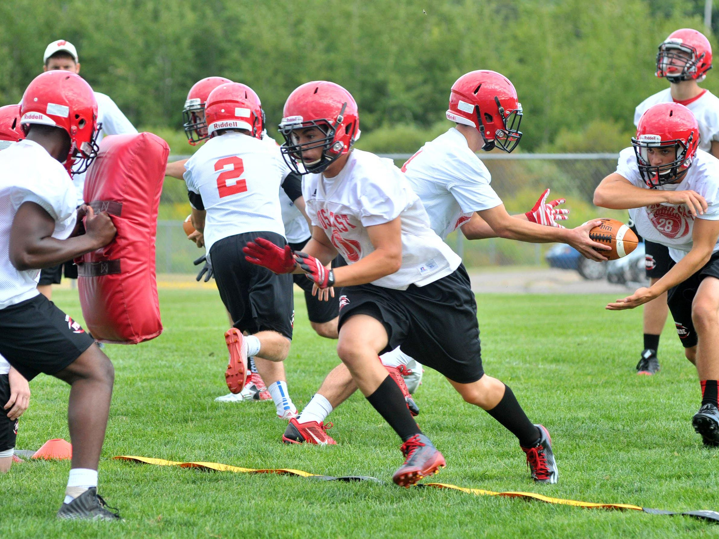 Wausau East football players work on a drill during Tuesday's first day of practice at Wausau East High School football field in Wausau.