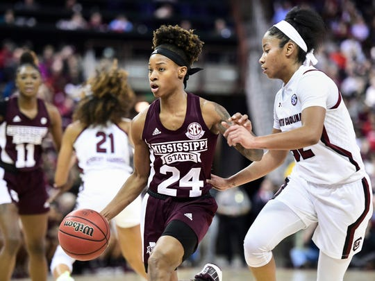 Mississippi State guard Jordan Danberry (24) dribbles the ball against South Carolina guard Tyasha Harris, right, during the first half of an NCAA college basketball game Monday, Jan. 20, 2020, in Columbia, S.C. (AP Photo/Sean Rayford)
