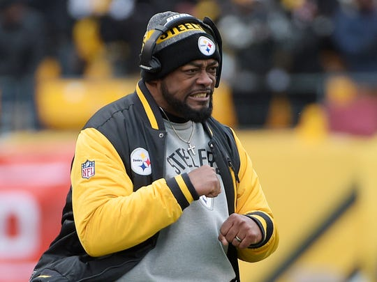 Pittsburgh Steelers head coach Mike Tomlin reacts on the sidelines during the first half of an AFC Wild Card NFL football game against the Miami Dolphins in Pittsburgh, Sunday, Jan. 8, 2017. (AP Photo/Fred Vuich)