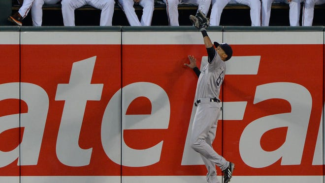 Yankees center fielder Mason Williams, here making a leaping catch of a fly ball, homered for his first major league hit on Friday.