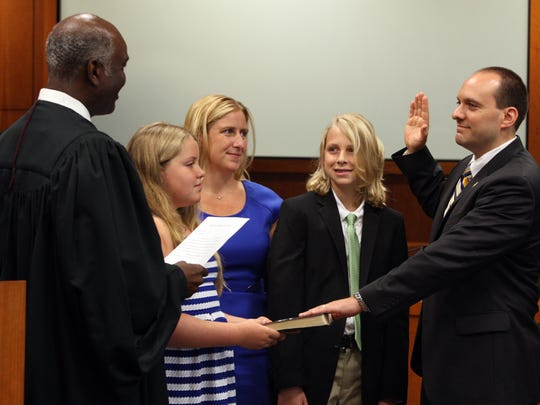 Andrew Carey, with family, is sworn in as Middlesex County prosecutor in 2014.