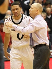 Cincinnati coach Mick Cronin talks with Jeremiah Davis