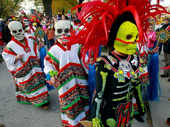 Marchers take part in the Dia de los Muertos parade