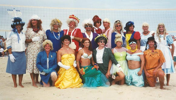 A group shot at one of the previous drag volleyball