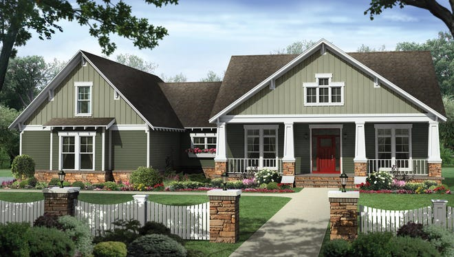 The wide front porch creates a welcoming, neighborhood-friendly look for this Craftsman home.