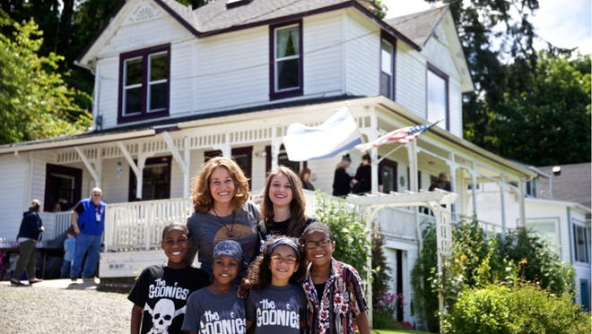 "This June 2014 photo shows Devonte Hart with his family at the annual celebration of ""The Goonies"" movie in Astoria, Ore. Authorities in Northern California say they believe all six children from a family were in a vehicle that plunged off a coastal cliff. Mendocino County Sheriff Tom Allmon told reporters Wednesday, March 28, 2018, that only three bodies of the children have been recovered. Their parents also died Monday. (Thomas Boyd/The Oregonian via AP)"