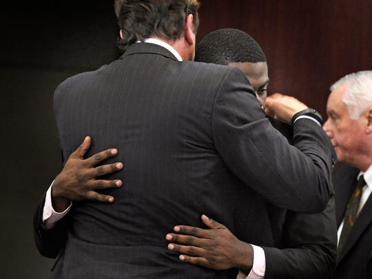 Cory Batey, facing camera, says goodbye to his attorney