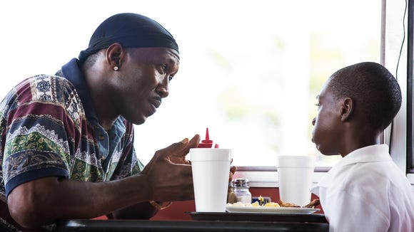 "Juan (Mahershala Ali, left) takes young Chiron (Alex Hibbert) under his wing in ""Moonlight."""