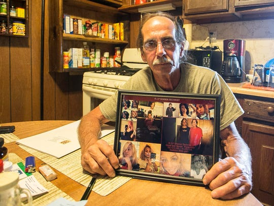 Billy Sechrist, of York City, holds a photo collage