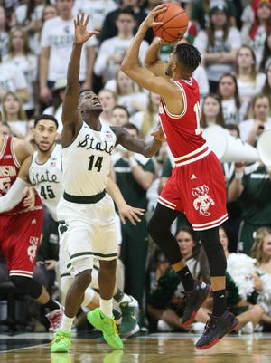 Michigan State's Eron Harris defends against Wisconsin's Jordan Hill during the first half of MSU's win Thursday in East Lansing.