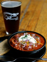A bowl of Mudhook Brewing Company's chili is shown with a pint of Red Eye Irish Red beer. Mudhook is hosting the Central Market Chili Festival on Jan. 28.