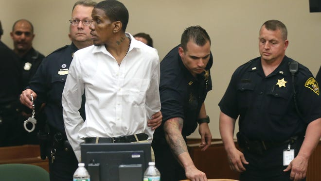 Thomas Johnson lll is handcuffed -- in Daryl Pierson's cuffs -- after his guilty verdict for aggravated murder May 8, 2015, in state Supreme Court.
