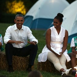 President and Mrs. Obama  are flanked by Daphnye Shell, left, of Peggs, Oklahoma, and Kennedi Pridget, right, of Maryland, during the first-ever White House Campout June 30, 2015, on the South Lawn of the White House in Washington, DC.