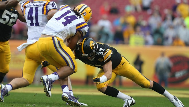Iowa defensive back John Lowdermilk hits LSU running back Terrence Magee in the Jan. 1 Outback Bowl.