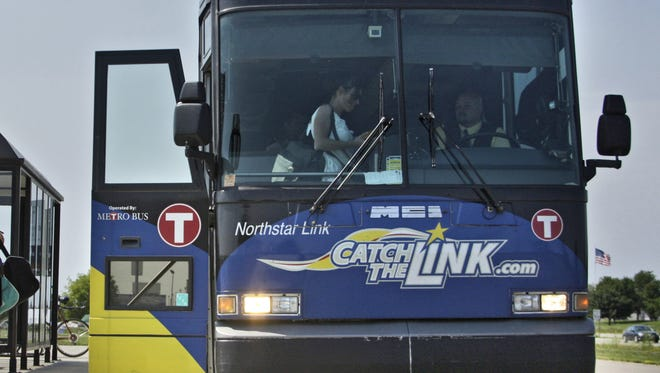 Riders board the Northstar Link bus at the east St. Cloud bus stop. The bus heads to Big Lake, where the commuter rail starts.