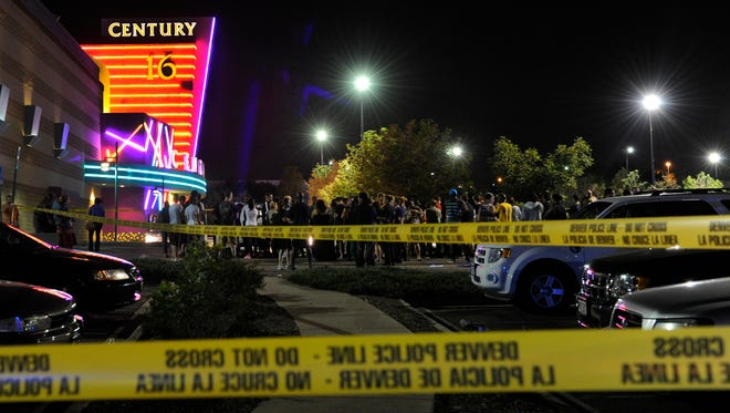 People gather outside the Century 16 movie theatre in Aurora, Colo., at the scene of a mass shooting early on July 20, 2012.