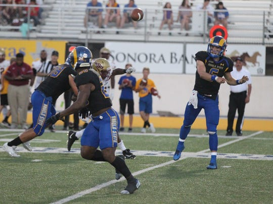 Angelo State University quarterback Charlie Rotherham fires a pass to running back Tyrese Nathan against No. 6 Midwestern State during a Lone Star Conference game at LeGrand Stadium at 1st Community Credit Union Field on Saturday, Oct. 14, 2017. MSU remained undefeated with a 41-27 win.