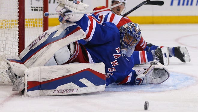 New York Rangers goalie Henrik Lundqvist (30) makes a save against the Florida Panthers.