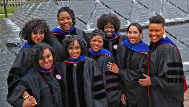 """Jada Phelps Moultrie (back row from left), Juhanna Rogers and Demetrees Hutchins, and (front from left) Nadrea Njoku, Jasmine Haywood, Johari Shuck, Shannon McCullough and Tiffany Kyser make up the """"great eight."""" All are earning doctorate degrees in education from the IU School of Education this weekend. The women formed a sister circle in school to strengthen their ties and have helped each other to be successful."""