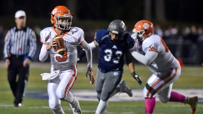 Central York quarterback Cade Pribula carries the ball in the second half of a YAIAA football game Friday, Oct. 28, 2016, at Dallastown. Central York defeated Dallastown 31-27.