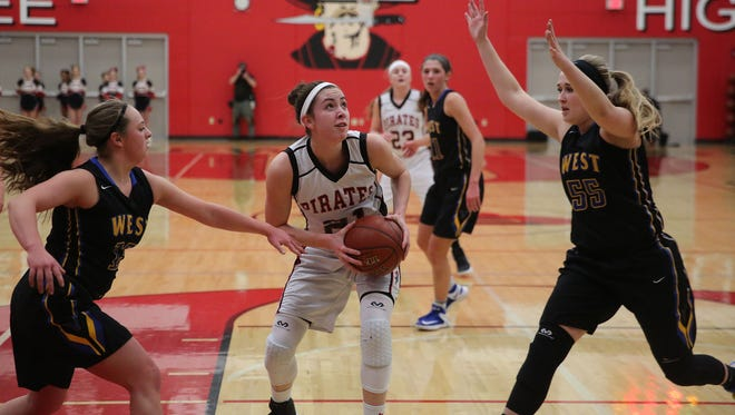 Pewaukee's Jinda Guidinger gets a shot off before New Berlin West's Skylar Berens and Maddie Fritz can get in to defend.