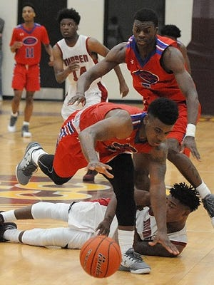 Evangel and Minden players scrap for the ball Saturday in the Paul Millsap Classic.