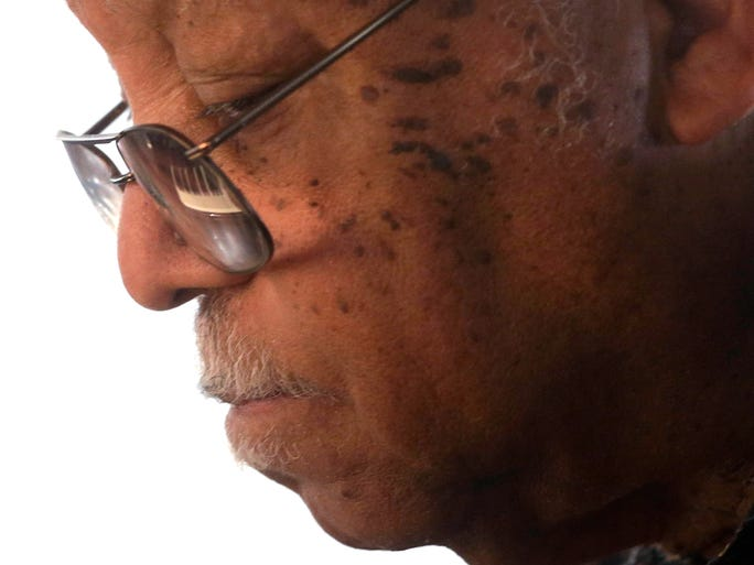 Piano keys are reflected in the glasses of Ellis Marsalis, father and musical teacher of his sons, artists Wynton, Branford, Jason and Delfeayo Marsalis, as he performs at the New Orleans Jazz & Heritage Festival on May 3, 2014.