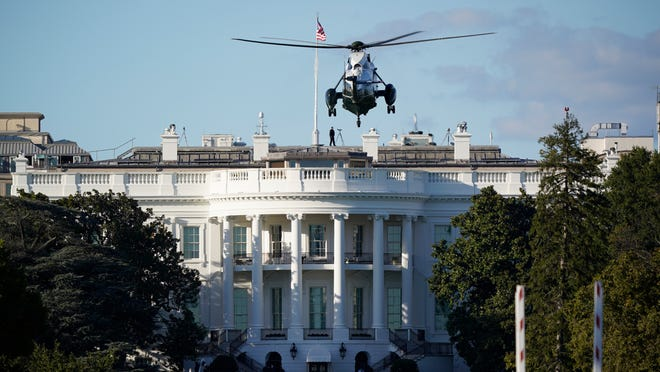 "The helicopter that will carry President Donald Trump to Walter Reed National Military Medical Center in Bethesda, Md., lands on the South Lawn of White House in Washington, Friday, Oct. 2, 2020. The White House says Trump will spend a ""few days"" at the military hospital after contracting COVID-19."