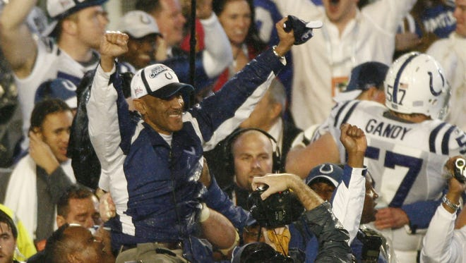 Tony Dungy is carried on the shoulders of his players after their Super Bowl XLI triumph. Seven weeks earlier, such was unthinkable.