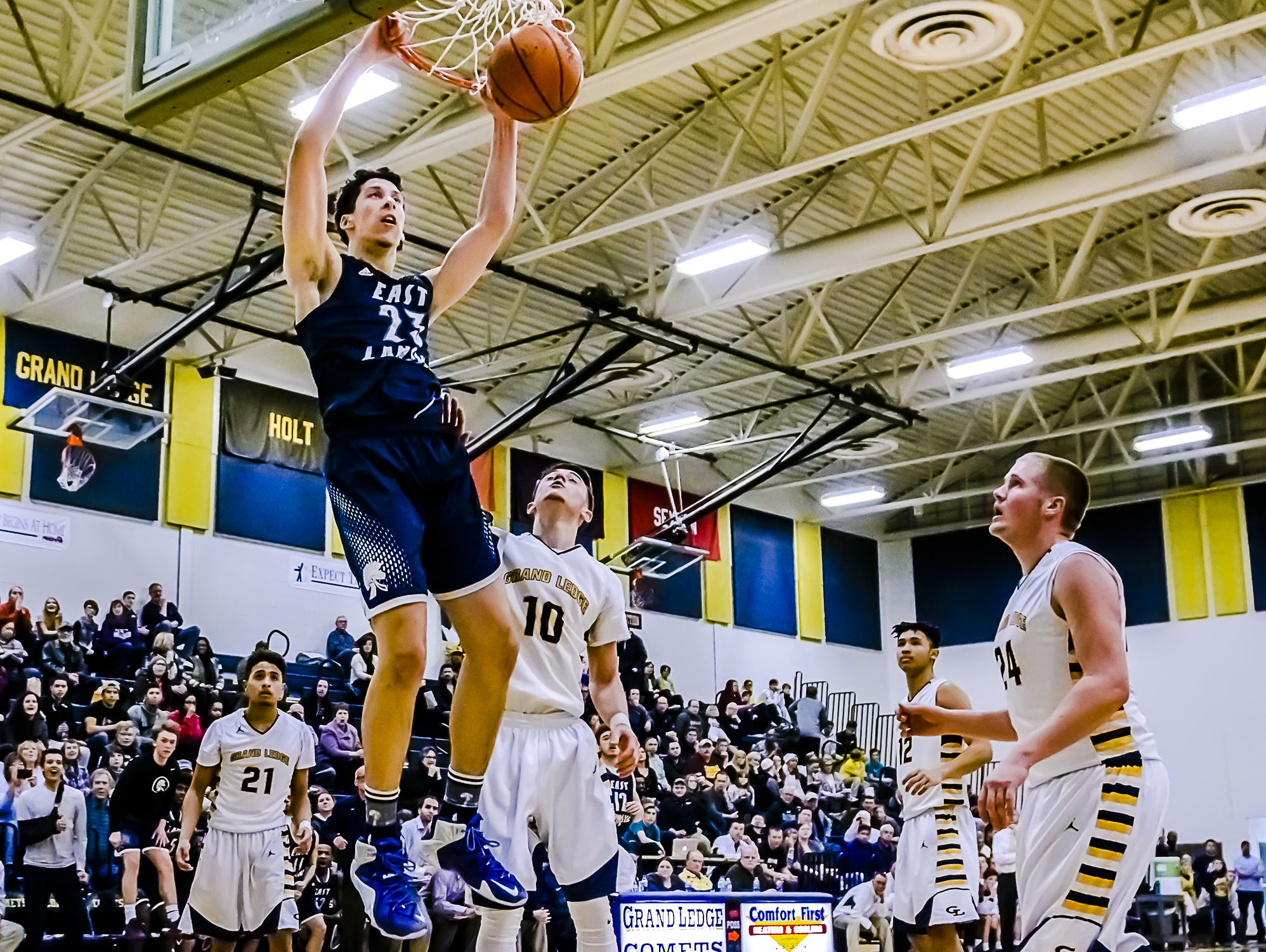 Brandon Johns, who is bucking the trend of the state's top players leaving for prep schools, is a top reason why East Lansing is a Class A state title contender.