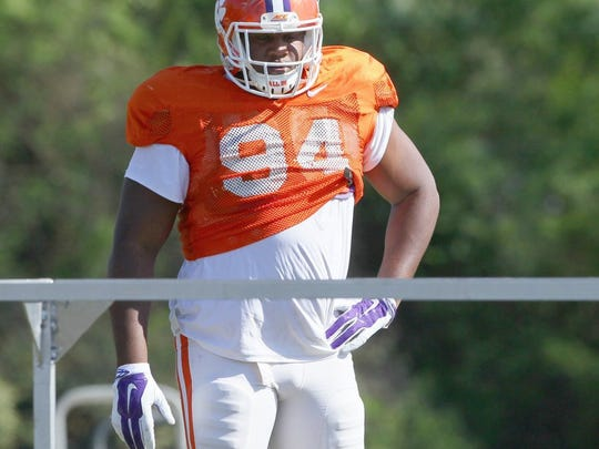 Clemson defensive tackle Carlos Watkins (94) watches a practice in Clemson.