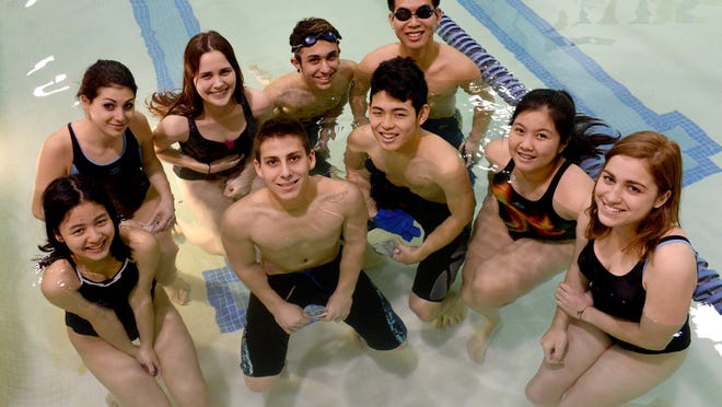 Ovid-Elsie High School has a swim team that includes 12 foreign exchange students, from 10 different countries, among the 30 on its roster. Here are nine of the students. Back row, from left: Francesca Rapagnani of Italy, Teodora Davidovic of Montenegro, Daniel Morera Trettin of Spain, Weijie Gu of China. Front row from left: Pattaranan Juthatungcharoen of Thailand, Pedro Campos of Brazil, Yuma Takeichi of Japan, Tan Ha of Vietnam, and Emma Kebel of Germany.