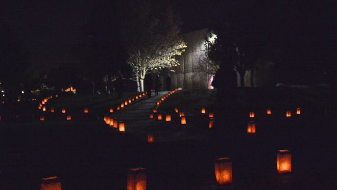 "Luminarias light the path to Garcia Hall during Sunday night's ""Noche de Luminarias"" held on the campus of NMSU."