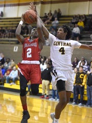 Mekhi Lairy of Bosse goes up for a layup as he is fouled by Malcolm DePriest Jr., of Central during the first quarter of the game at Central High School in Evansville Wednesday.
