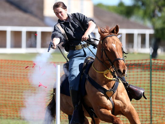 Autumn Ehler shoots a balloon during the Regional Cavalry