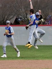 Clyde's Cayden Rollins, right, celebrated after a diving catch in left field.