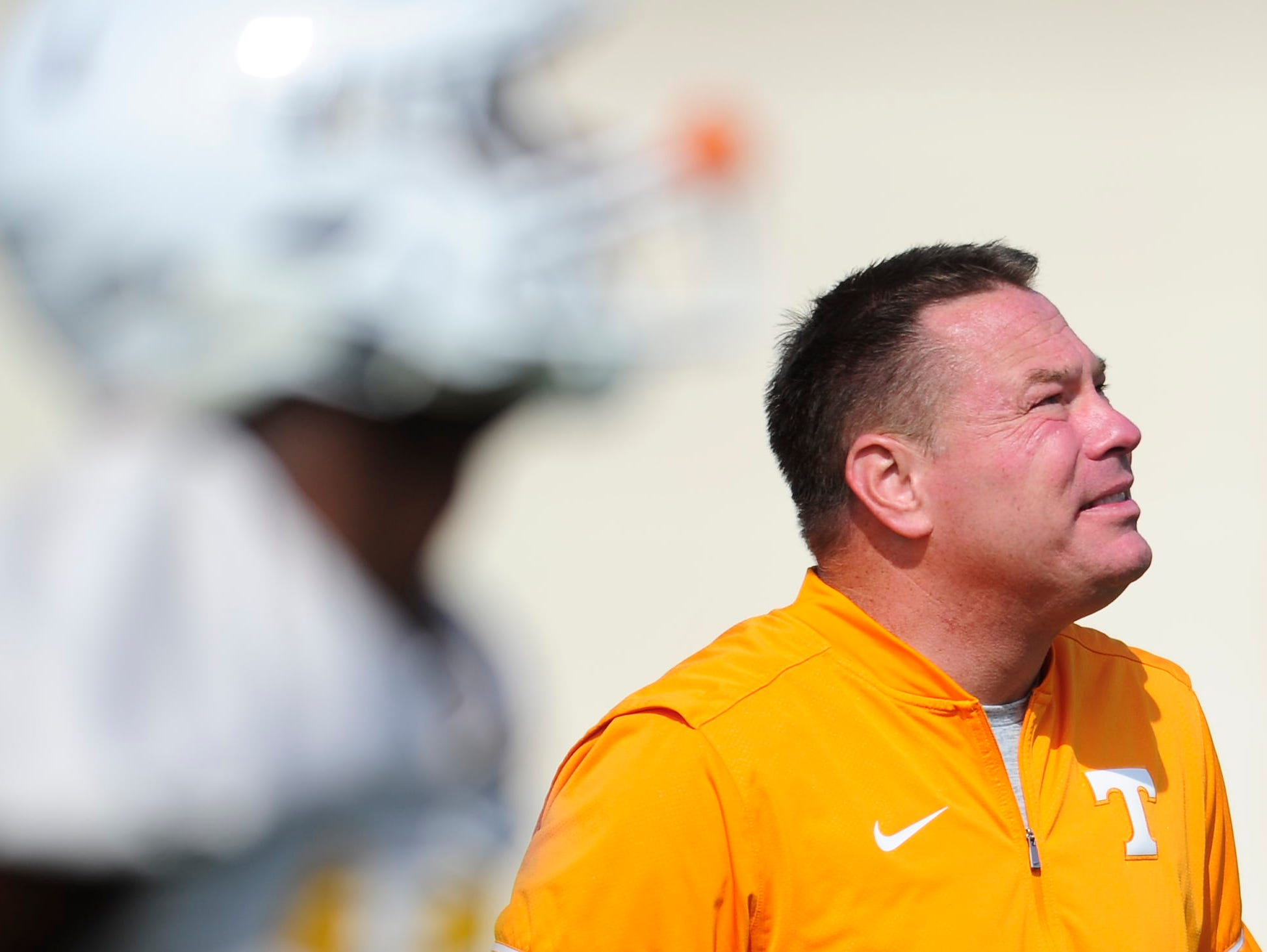 Head Coach Butch Jones watches during Tennessee Volunteers football practice at Anderson Training Facility in Knoxville, Tennessee on Thursday, March 23, 2017.