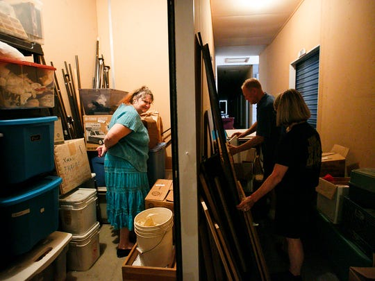 Renae Winters surveys her newly organized storage unit in Stayton on Tuesday, June 20, 2017. After several hours with organizers Julie Starr Hook and David Peters, boxes were no longer stacked to the ceiling and a small pathway had been created to access remaining items. Winters was eventually able to get rid of the storage unit.
