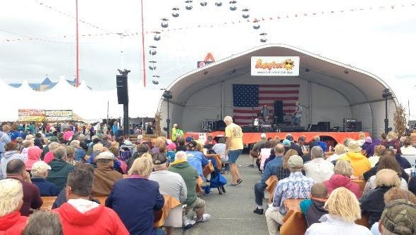 A crowd gathers at the OC Inlet on Saturday, Sept. 26, 2015, to listen to a live band at the annual Sunfest festival in Ocean City.