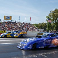 NHRA Funny Car drivers Jack Beckman, near, and Ron Capps race in the finals of the 2017 Summernationals at Old Bridge Township Raceway Park in Englishtown, N.J.