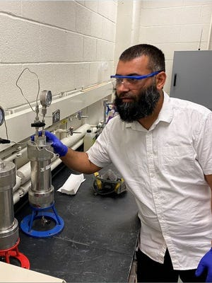 Dr. Imqam working in his S&T laboratory.