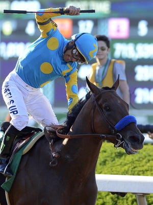 Victor Espinoza reacts after guiding American Pharoah to win the 147th running of the Belmont Stakes horse race at Belmont Park.